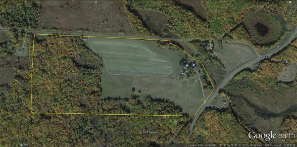 "Aerial photo of 83 acre Seever property (inside yellow line), formerly known as the ""Miniature Horse Farm,"" being acquired by the Friends of Hunt Hill. It is located across Audubon Road, just south of Hunt Hill Prairie, with a portion fronting on County M (on right side of photo). The farm field in the center of the photo has served as Prairie Fling parking the last two years. Pepper Creek flows out of Hunt Hill into Long Lake along the east, or right-hand, side of the Seever property."
